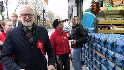 Jeremy Corbyn in jubilant mood meeting supporters on way to London polling station