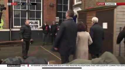 Jeremy Corbyn's minder battles with Elmo as he arrives to vote