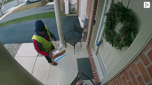 A delivery man dances joyfully when finding some snacks for him in a house