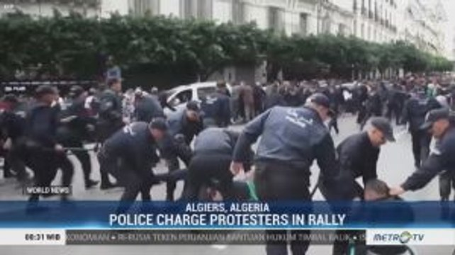 Police Forces Charge at Protesters During an Anti-Election Rally in Algeria