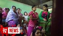 Rohingya weep in Myanmar court as they face charge of illegal travel