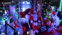 Santa Claus entertains Christmas shoppers in Bangkok
