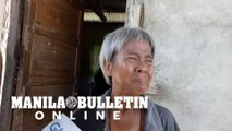 An elderly woman recounts what happened to her family during Typhoon Ursula in Batad town, Iloilo
