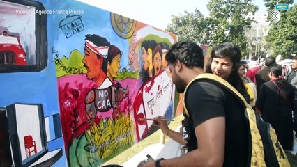 Indian protesters paint angry messages against new law