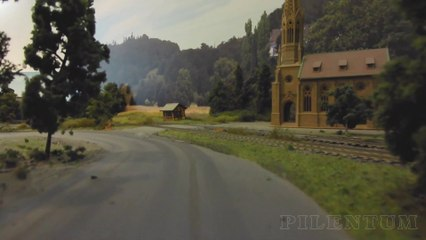Trains and Trucks: Car System Cab Ride (FPV) on the Streets of a Model Railway Layout - Video by Pilentum Television about rail transport modeling, trains, model railroading, railway modelling, model railways and model railroads