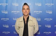 Robbie Williams: I still love working