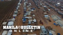 Syria: Mud surrounds a displaced camp north of Idlib due to heavy rain