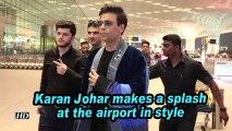 Karan Johar makes a splash at the airport in style