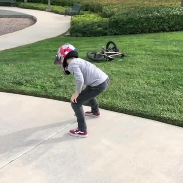 Kid Does Amazing Backflip Over Ramp While Riding BMX bike