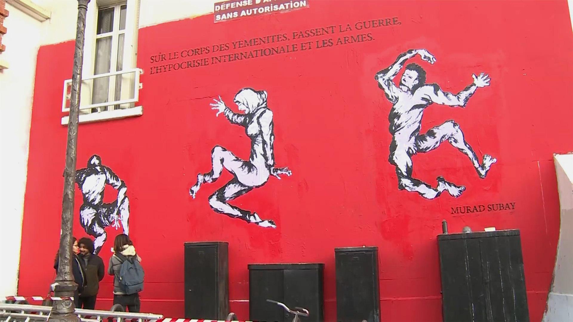 لوقف الحرب باليمن.. فنان يمني يرسم مأساة بلاده على جدران باريس