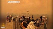 Residents flee towards the sea as Australian bushfires intensify