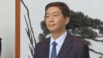 China's new man in Hong Kong hopes city will return to 'right path'