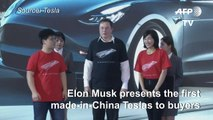 Elon Musk delivers first batch of made-in-China Teslas to customers