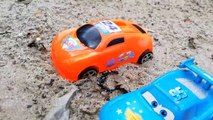 A Lot Of Toy Cars For Kids Moving Through The Sand To Car Tire At Kids Playground