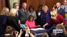 Pelosi Signs Articles Of Impeachment Against Trump, Gives Pens Out To Colleagues