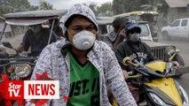 Philippine residents retrieve animals, belongings amid threat of volcano eruption