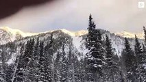 They videotape an impressive avalanche of snow that covers a road in the US