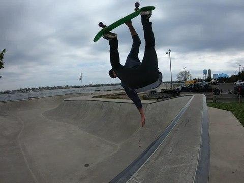Skateboarder Slides Up Wall and Does Backflip