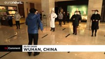 Quarantined hotel workers in Wuhan do exercises to stay active