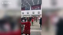 Coronavirus nurses in protective clothing dance with quarantined patients in Wuhan