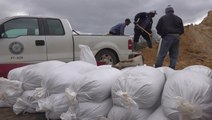 People do what they can to prepare for incoming flooding