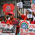 'Show of love for democracy': Groups hold Red Friday protest to support ABS-CBN