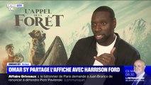 """""""Je suis comme un môme"""": Omar Sy raconte son tournage avec Harrison Ford dans """"L'appel de la forêt"""""""