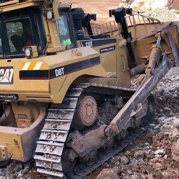 Cat D8T Bulldozer Pushing Huge Rocks