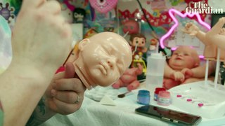 Fake babies, real love: the women who care for lifelike baby dolls - video