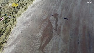 Retiree Pays Homage to Surfing With 150ft Beach Sketch Made Using Only a Rake