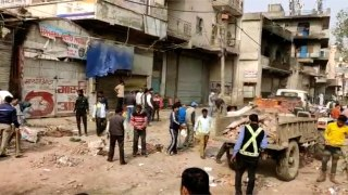 People removing the blockades at Chandbagh area as situation restores to no...