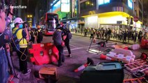 Hong Kong police fire tear gas as protesters return to streets despite coronavirus fears