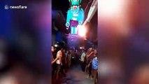 Mumbai people burn effigy of 'coronavirus monster' during Holi festival