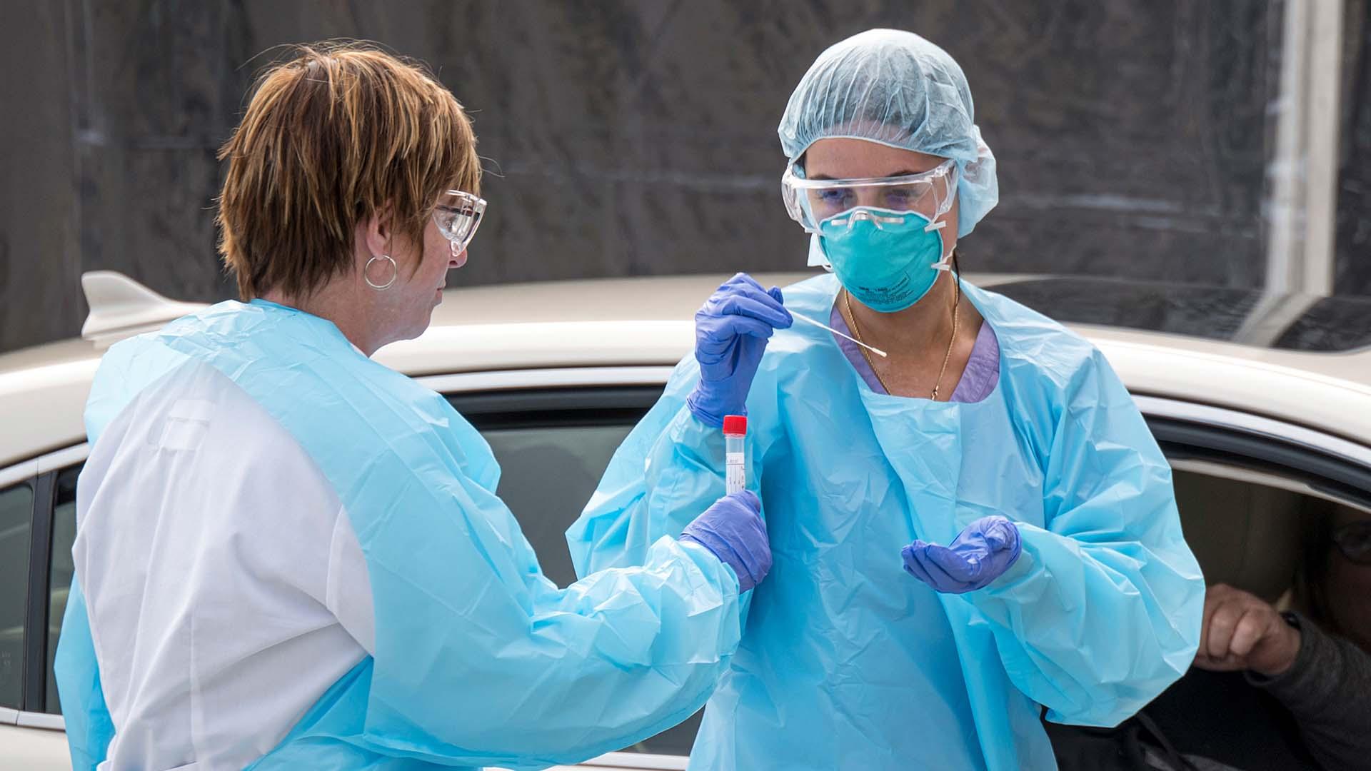 Disease expert tells Americans to 'hunker down' as US tightens coronavirus measures