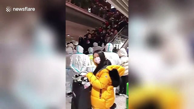 Overseas travellers waiting to be quarantined are stranded at Beijing International Airport