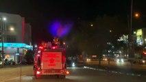 百利镇自愿消防队出动消防车消毒街道