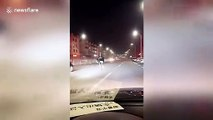 Ostrich runs along busy road after strong winds blew over its shed in China