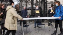 Activists block Downing Street gates with dinner table in protest to government approach to coronavirus