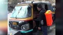 Auto-rickshaws disinfected to stop spread of coronavirus outbreak in northern India