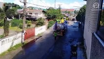 Volunteers sanitize Tacloban streets to contain coronavirus