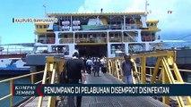 Penumpang dan Kendaraan di Pelabuhan Disemprot Disinfektan