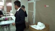 'Merdiven altı' maske üreten adrese operasyon: Bin 500 maske ele geçirildi