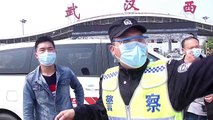 Vehicles queue up on highway to enter Wuhan after nearly two-month coronavirus lockdown