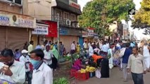 People violate social distancing rule amid India lockdown in Karnataka's Hubli