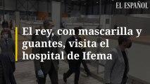 El rey, con mascarilla y guantes, visita el hospital de Ifema.