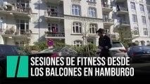 Un entrenador ayuda a sus vecinos a hacer ejercicio desde sus balcones