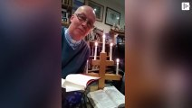 A vicar's sweater lights up during virtual sermon