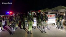 Filipino soldiers dance to stay upbeat while manning COVID-19 checkpoint