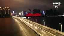 Coronavirus: les rues vides de Wuhan, à la lueur des réverbères