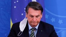 Brazil's president downplays threat of pandemic as coronavirus spreads deeper into Latin America